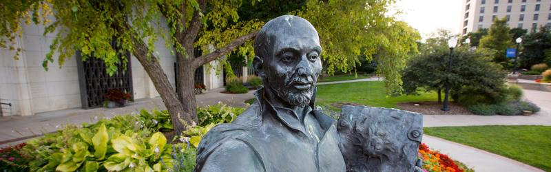 St. Ignatius statue outdoors on Creighton campus
