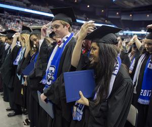 Graduates move their tassels at commencement ceremony
