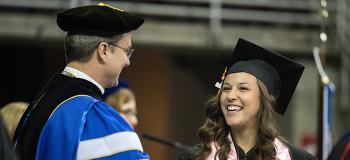 Fr. Hendrickson with graduating student